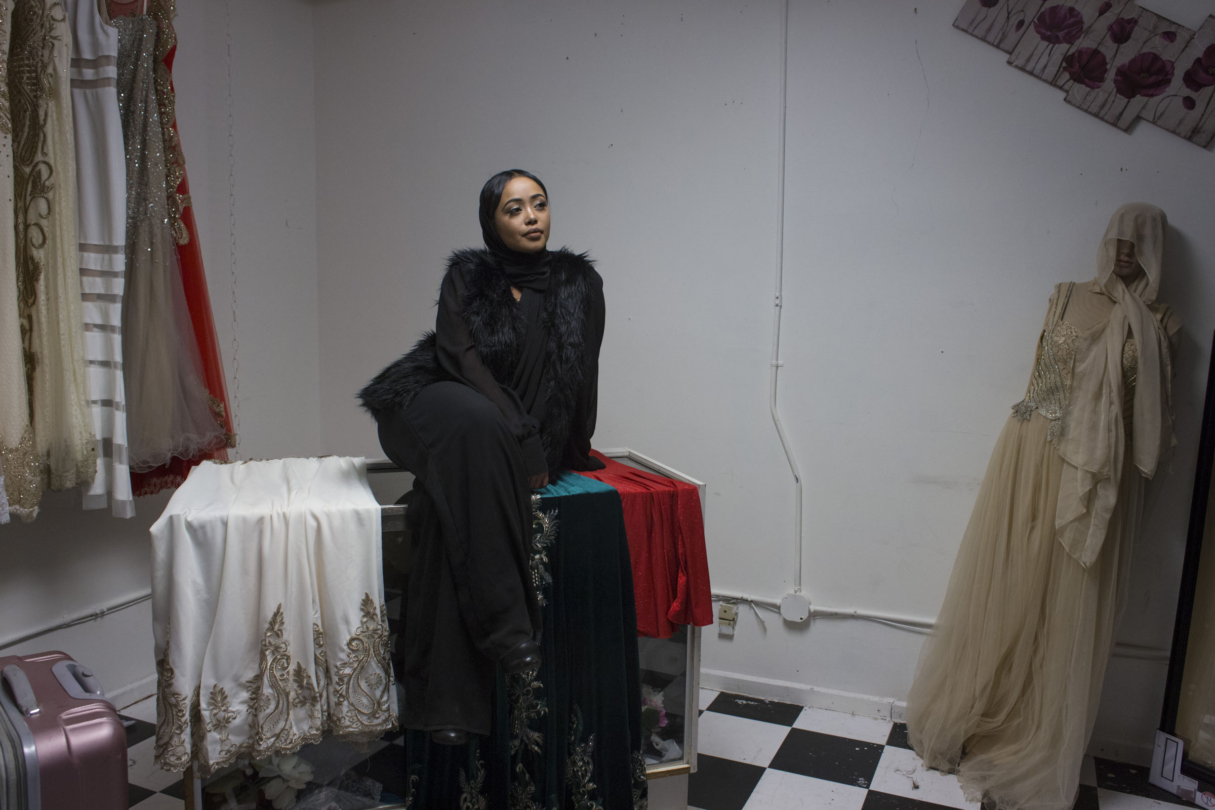 Sumaya Keynan, 24, in her small shop within her grandparents' mall in Cedar-Riverside, Minneapolis, Minn., on Wednesday, October 11, 2017. Keynan hopes her fashion and beauty brand appeals to young Muslim women who want to be both modest and fashionable. She also hopes to appeal to all audiences of women and already has a customer base in Europe. (Photo by Brittany Greeson)