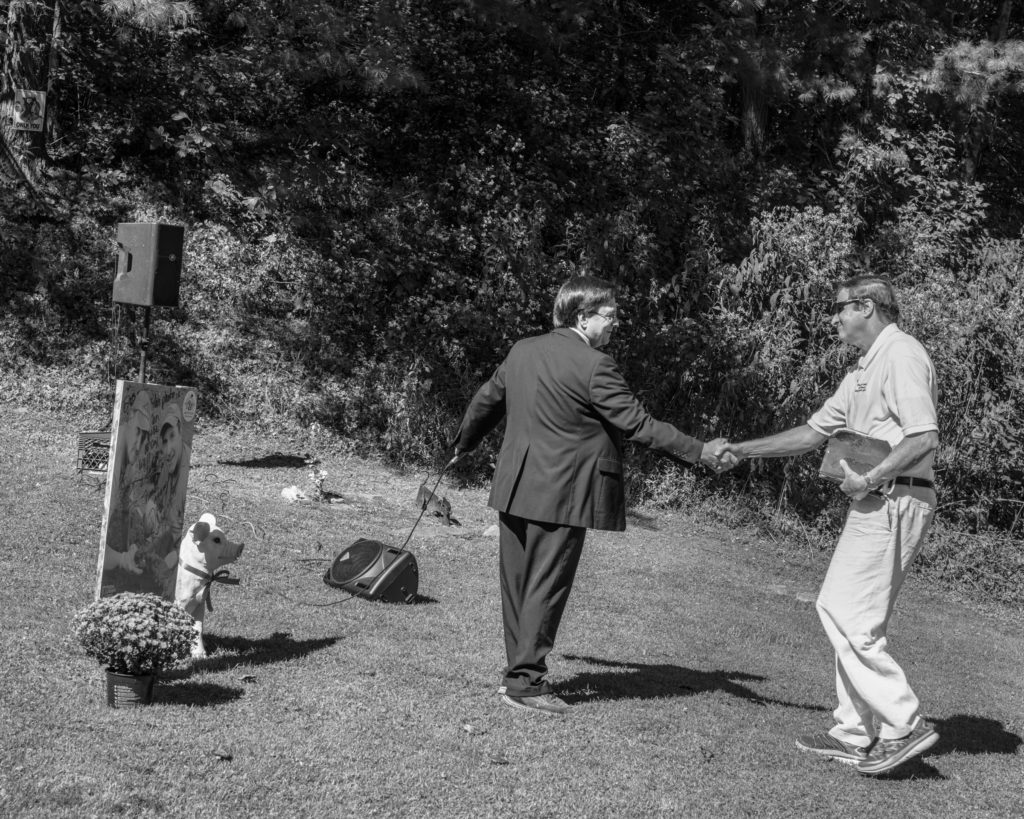 Ron McCoy (left) and Billy Hatfield shake hands at the former Randolph McCoy cabin site, which was attacked by a group of Hatfield men in 1888. (Photo by Ben Brody)