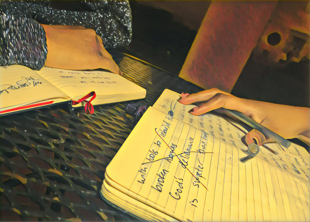 Amal Hussein and Hamdi Mohamed work on poems together (Photo by Ian Coss with Prisma filter)