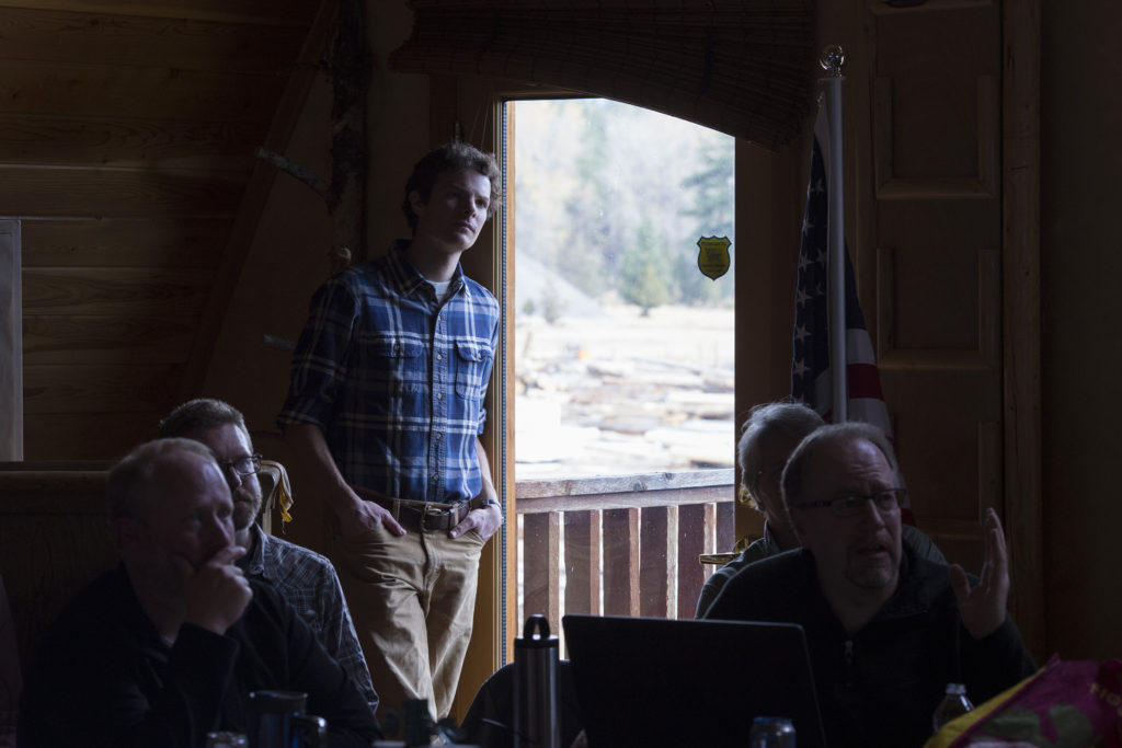 Zack Porter, of Missoula, listens in on the Southwestern Crown Collaborative quarterly meeting in Seeley Lake, Montana, on Thursday, October 19, 2017. (Photo by Brittany Greeson)