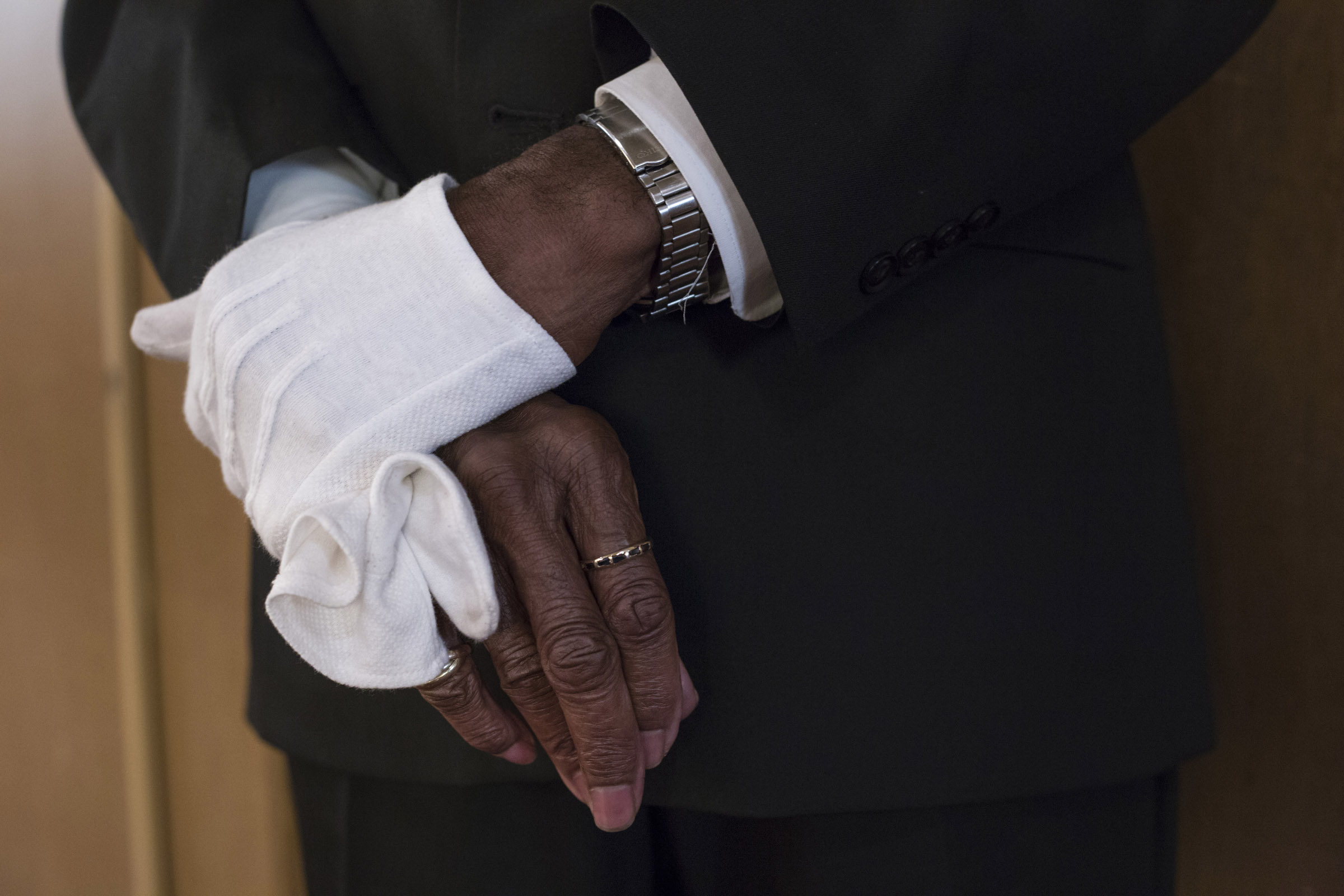 Alexander Williams, 76, holds his glove while listening to the sermon at Third Baptist Church in the Fillmore district of San Francisco, California, on Sunday, November 5, 2017. (Photo by Brittany Greeson)