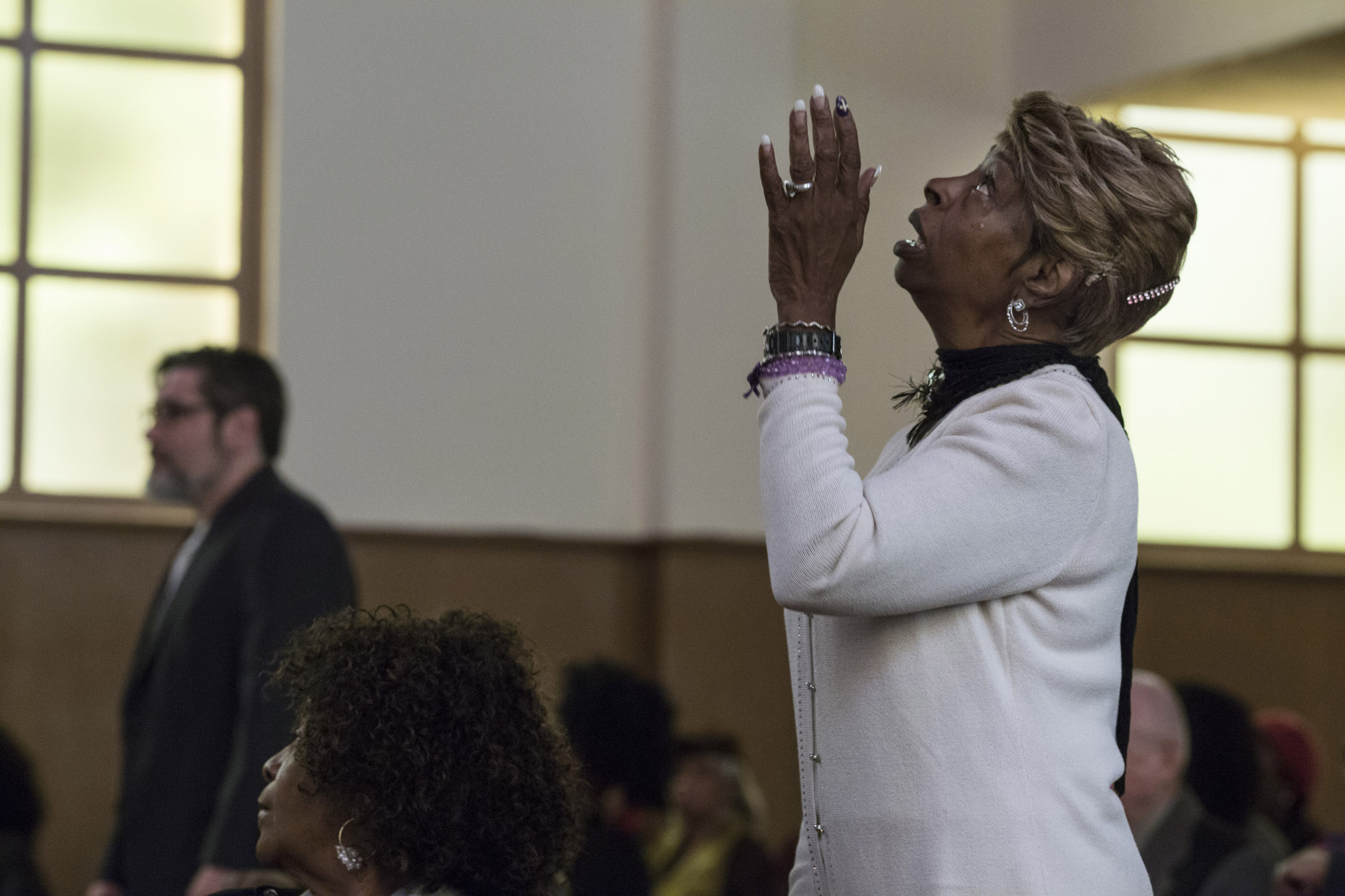 Elaine Buchanan, raises her hands in praise during the service at the Third Baptist Church in the Fillmore district of San Francisco, California, on Sunday, November 5, 2017. (Photo by Brittany Greeson)