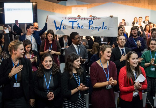 "People disturb an event titled: ""The Role of Cleaner and More Efficient Fossil Fuels and Nuclear Power in Climate Mitigation"" with friendly singing at the COP 23 United Nations Climate Change Conference on November 13, 2017 in Bonn, Germany. The event, organized by the Trump administration and led by a delegation of U.S. coal, nuclear power and gas energy representatives, seeks to make the case for the ongoing use of the three power sources in bridging current global energy demand and the developing capacity of renewable energy sources. (Photo by Lukas Schulze/Getty Images)"