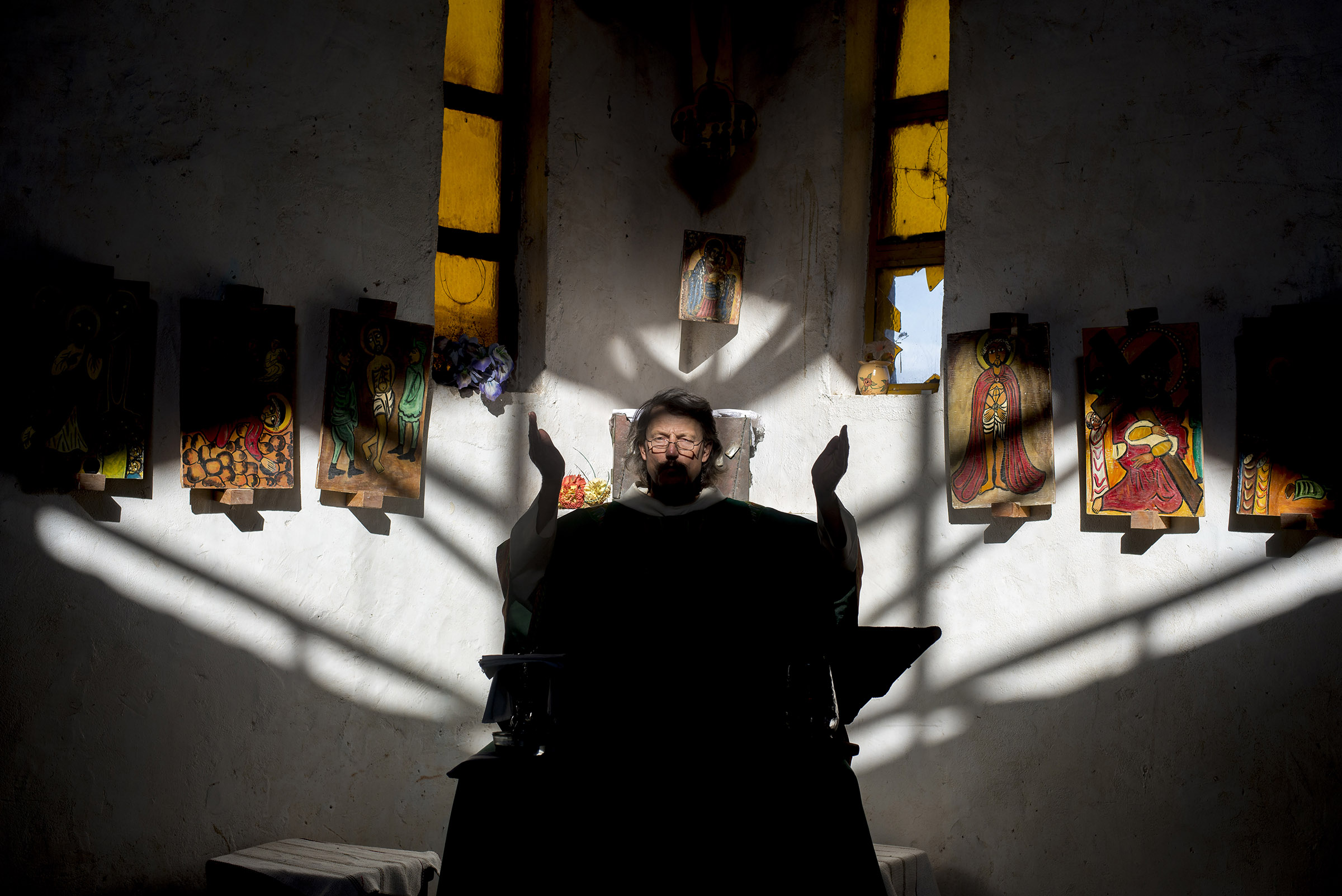 Father Florian, a Benedictine monk, leads an afternoon service in Illeret, Kenya. A Bavarian prince, he has lived in Kenya for over 20 years and has been working in Illeret with the Daasanach, a semi-nomadic tribe, for more than a decade. (Christena Dowsett/The GroundTruth Project)