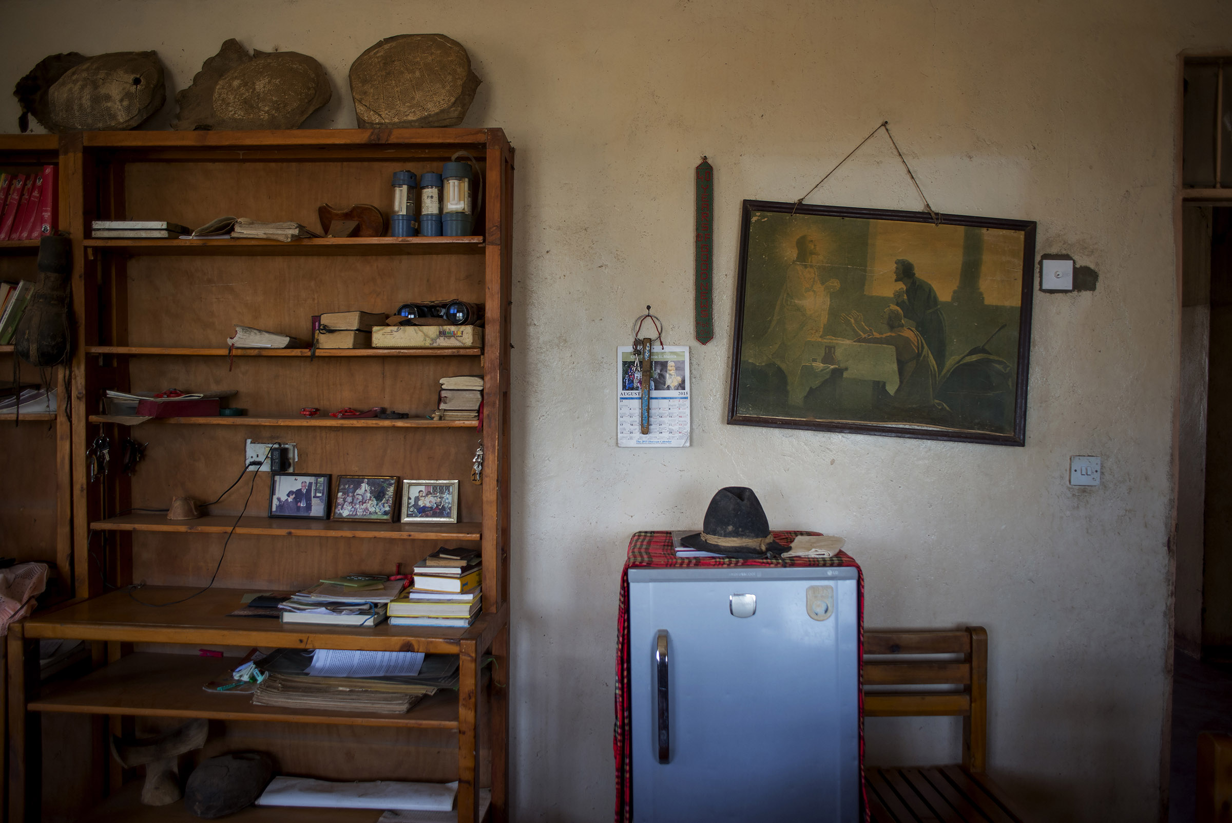 The dining room of St. Peter the Fisherman parish in Illeret, Kenya. Father Florian is known for wearing his German hat, except during meals and church services. (Christena Dowsett/The GroundTruth Project)