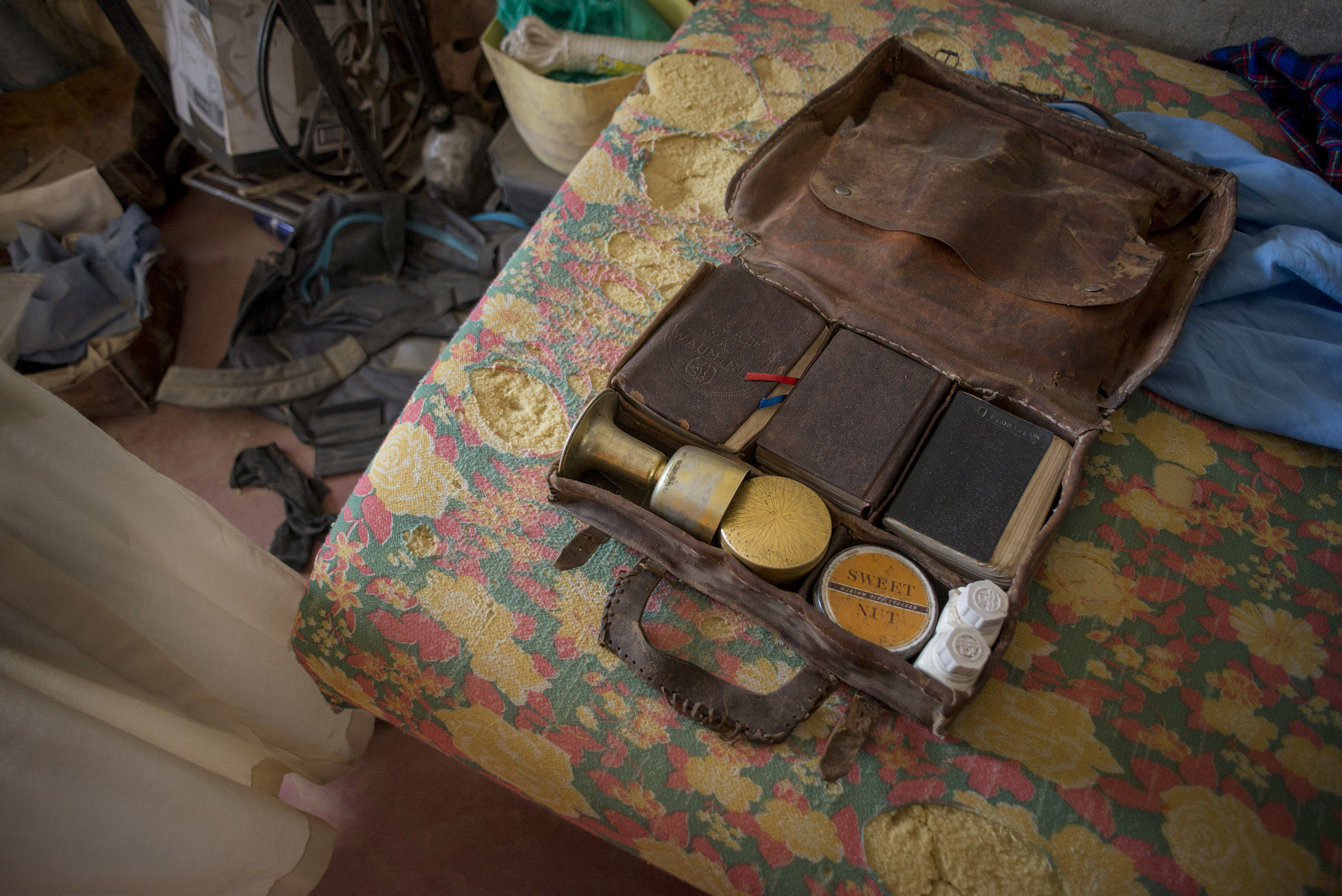Father Florian often travels to remote areas for ministry work and always keeps a travel kit with him to carry out the sacrament of the Eucharist. (Christena Dowsett/The GroundTruth Project)