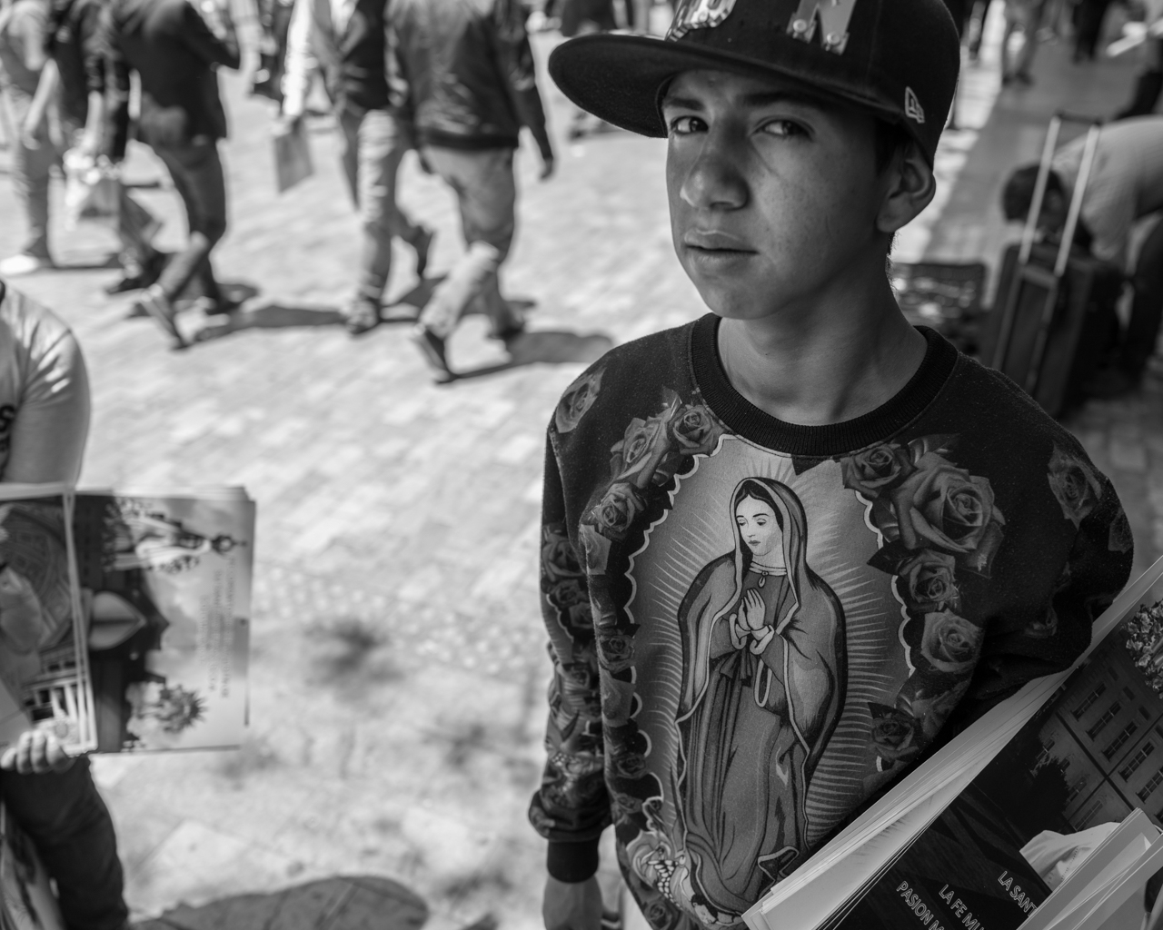 A young man sells religious merchandise, prior to a visit by Pope Francis. Sept. 6, 2017. (Juan Cristóbal Cobo)