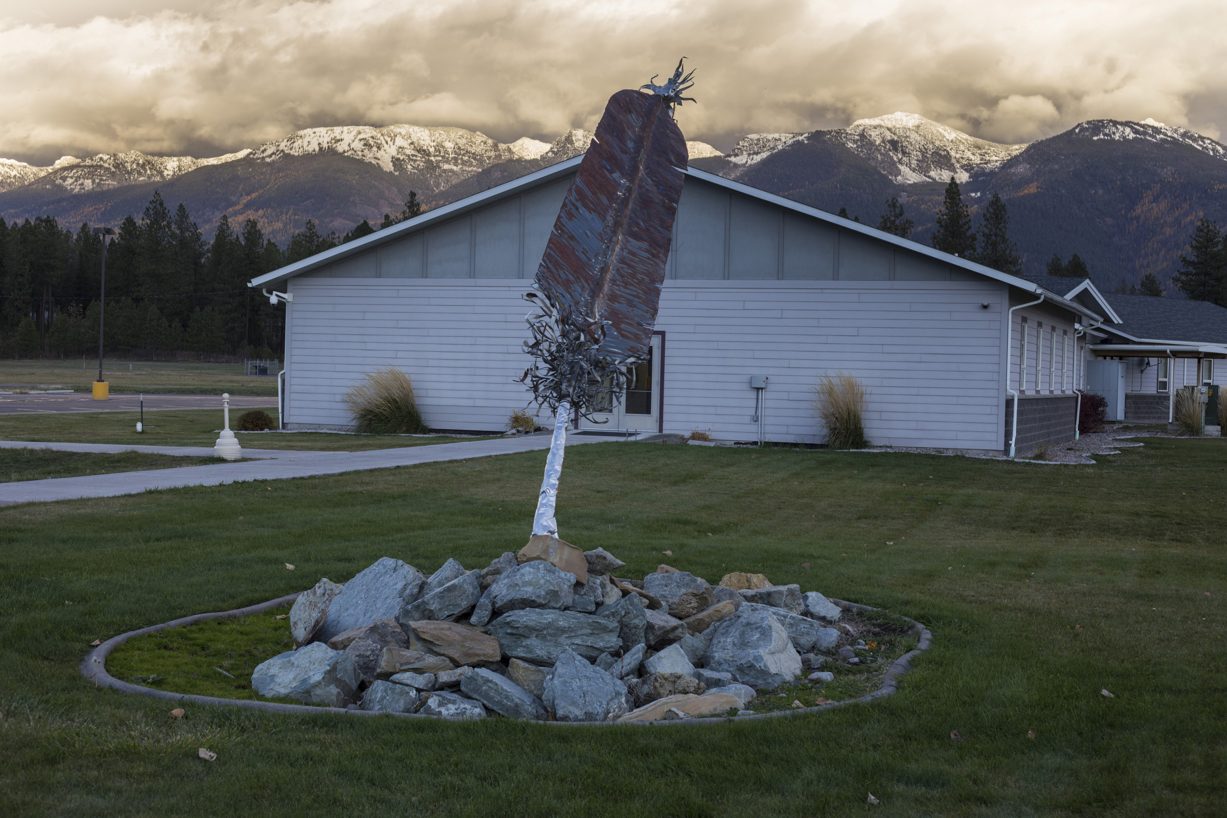 A sculpture of a feather sits nearby the Salish Kootenai College in Pablo, Montana, on Sunday, October 22, 2017. (Photo by Brittany Greeson)