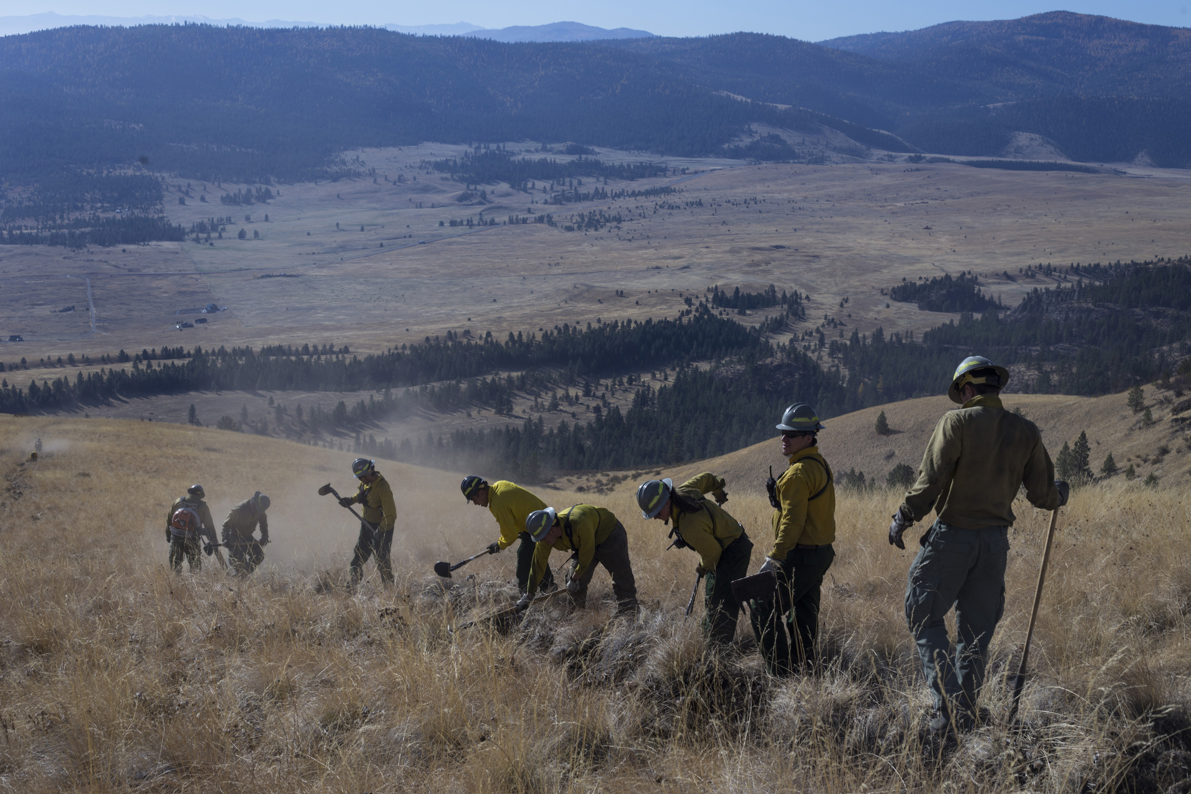 Members of the Confederated Salish and Kootenai Tribes Division of Fire prepare a barrier for a prescribed burn just along a ridge line outside of Elmo, Montana, on Tuesday, October 24, 2017. (Photo by Brittany Greeson)