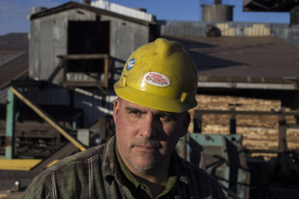 Todd Johnson, 52, stands outside of Pyramid Mountain Lumber Inc. in Seeley Lake, Montana, on Thursday, October 29, 2017. Pyramid Mountain is the oldest family owned and operated sawmill in the state of Montana. Johnson is a third generation worker for the sawmill. (Photo by Brittany Greeson)