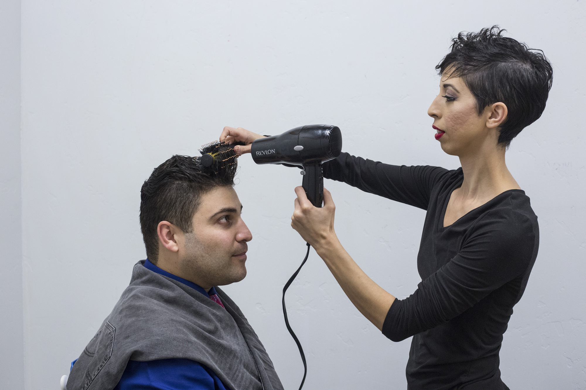 Omar's wife, Jasmín, helps him fix his hair before their performance. Jasmín, a contemporary flamenco and modern dancer, is Omar's frequent collaborator. (Brittany Greeson/The GroundTruth Project)