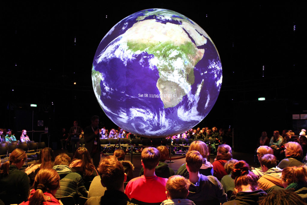 """German students inside the """"Climate Planet"""" in Bonn, Germany, where the latest United Nations climate conference was held. (Katie Worth/GroundTruth)"""
