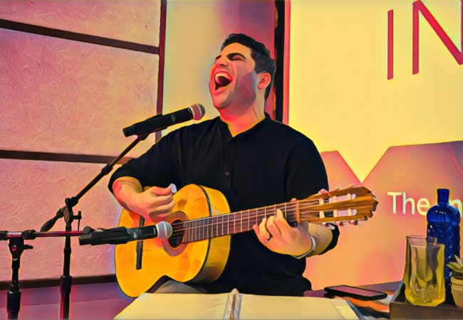 Omar Naré runs through a song prior to his show, VIVO: A Chicano Performance, at the BitWise, a tech hub with a long, rectangular theater in downtown Fresno, California, on Saturday, November 11, 2017. (Photo by Brittany Greeson with Prisma filter)