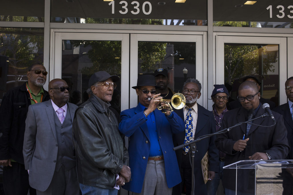 Dr. David Hardiman plays the trumpet during a rally outside the Fillmore Heritage Center. (Photo by Brittany Greeson)