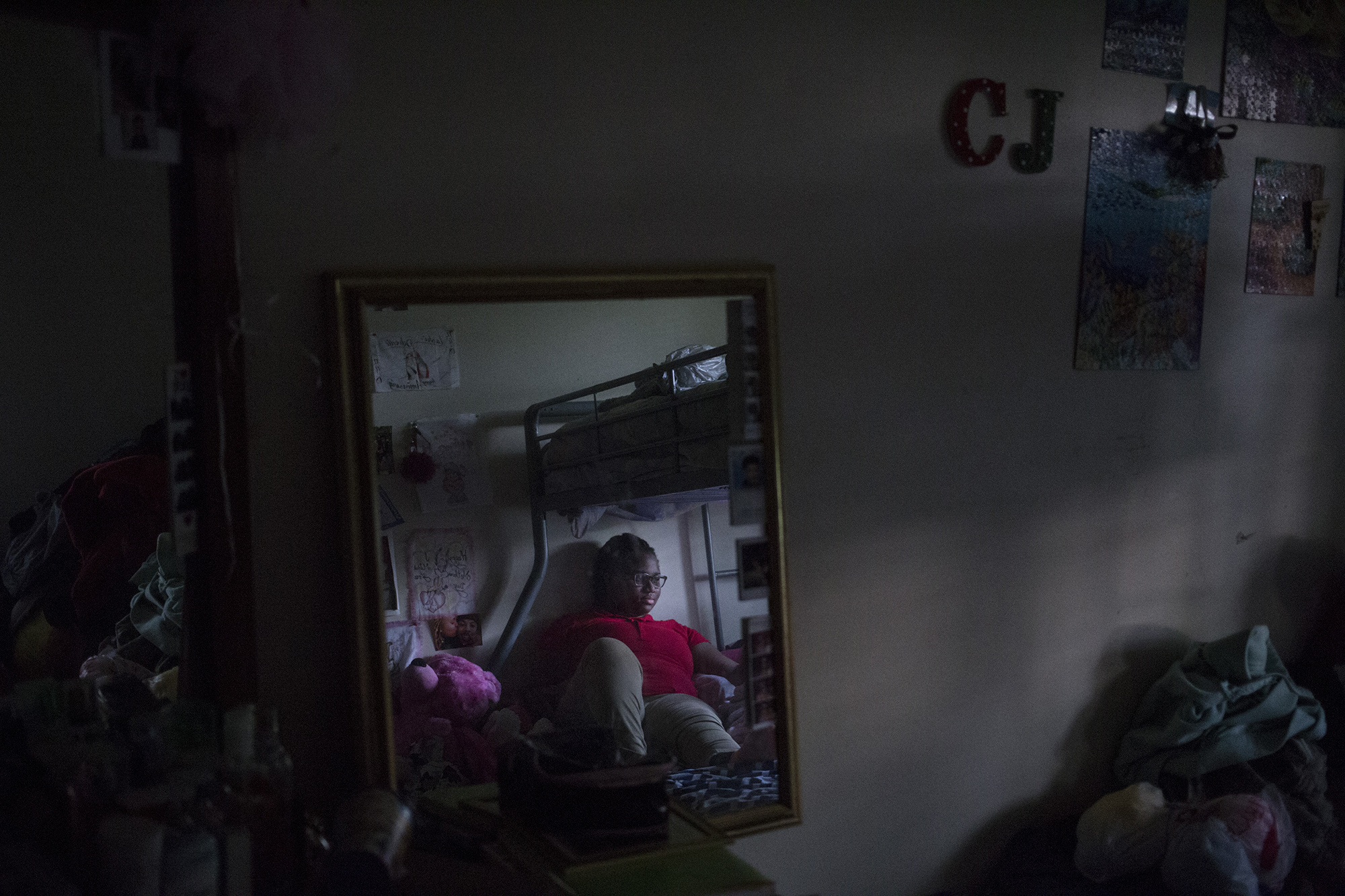 Tre'ana Taylor, 17, in the bedroom she shares with her sister and niece at her home in Springfield, Mass., on Monday, September, 11, 2017. When she was 15, Taylor became pregnant and her son, CJ, died after he was born prematurely. She has high hopes of being a mother again, after she's completed her schooling to become an OB/GYN. (Brittany Greeson/GroundTruth)