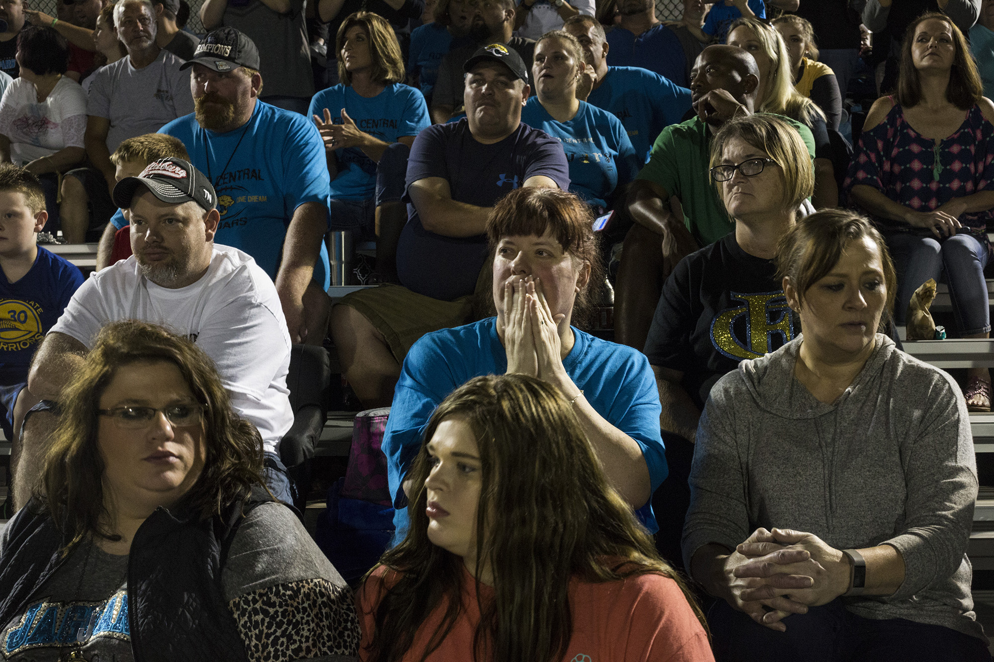 Angie Heard Minnie, center, watches intently as a play is made during a football game at Floyd Central High School in Langley, Ky., on Friday, September 22, 2017. (Brittany Greeson/GroundTruth)