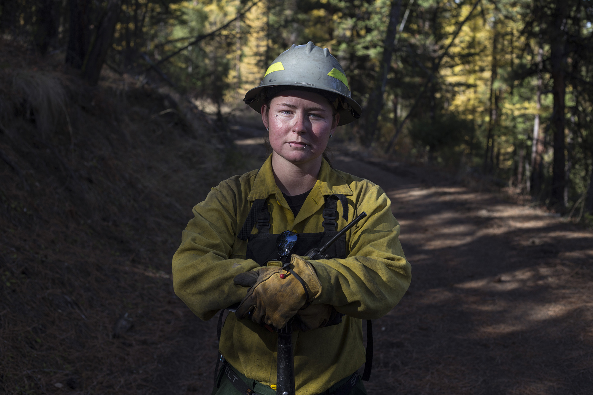 Lindsay Burland Roullier, 27, an enrolled member of the Confederated Salish and Kootenai Tribe, a forest technician and wild and fire fighter, at the site of a controlled burn she had been working on outside of Elmo, Mont., on Tuesday, October 24, 2017. Roullier's father worked as a member of the CSKT Division of Fire for nearly 22 years when he was killed by a drunk driver coming home from work. She said she started working in the Division of Fire to honor his legacy. (Brittany Greeson/GroundTruth)
