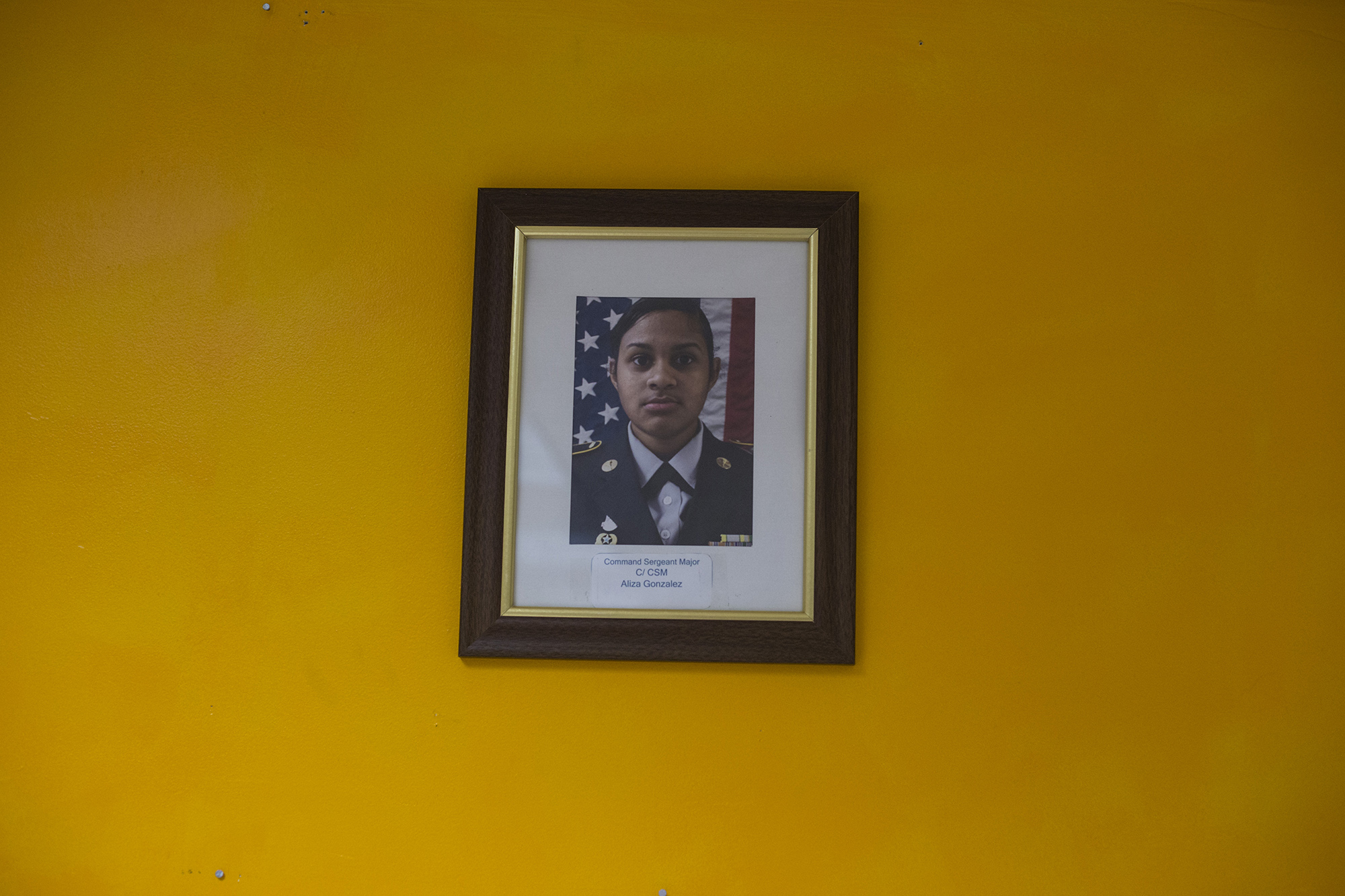 A single photograph featuring Command Sergeant Major Aliza Gonzalez hangs on the wall in a JROTC classroom in Springfield, Mass., on Monday, September, 11, 2017. (Brittany Greeson/GroundTruth)