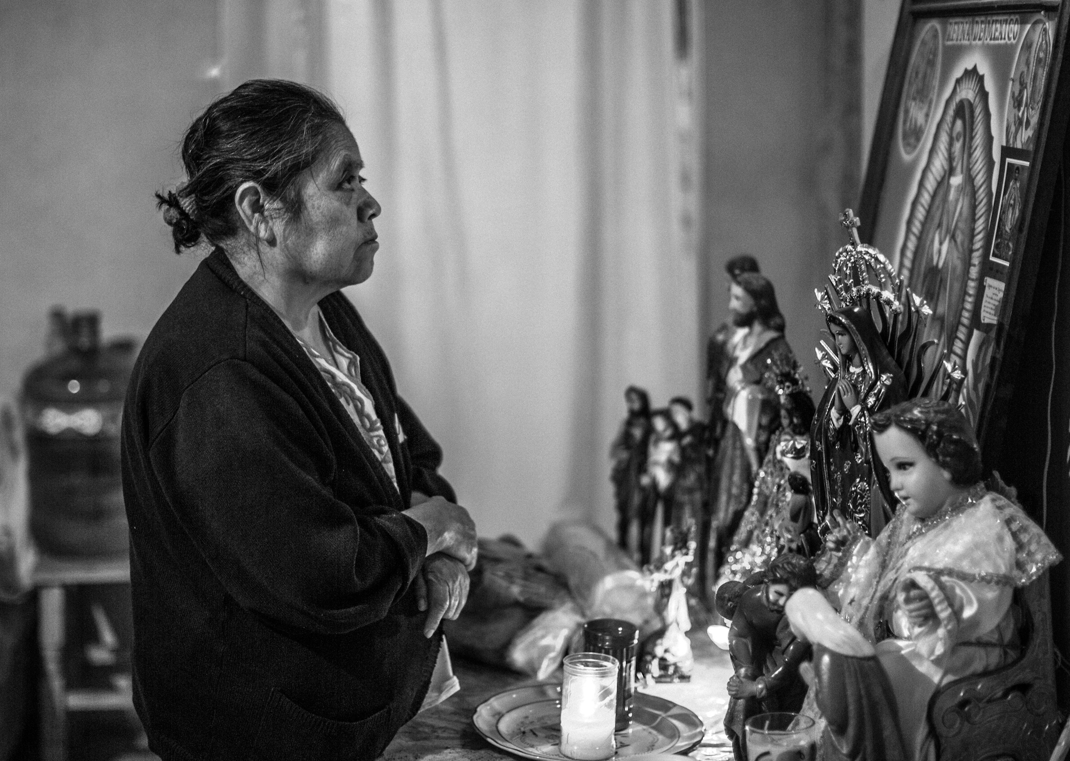 Angelo Cabrera's mother, Irma, prays for her son in San Antonio Texcala, Mexico. (Maite H. Mateo/GroundTruth)