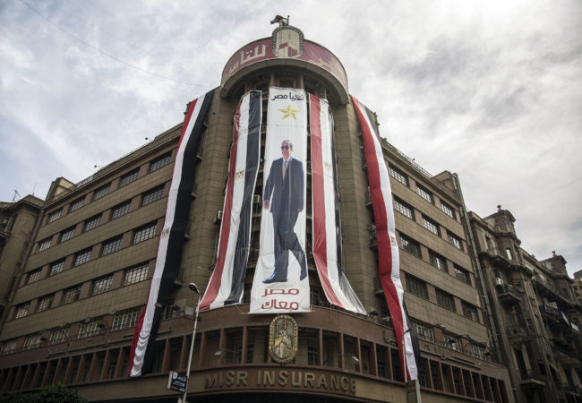 A Sisi banner hangs in Cairo. After a democratic election in 2012 that put the Muslim Brotherhood in power, Sisi led a coup that overthrew the democratically-elected president, and banned the Muslim Brotherhood and pro-democracy demonstrators. (Roger Anis/GroundTruth)