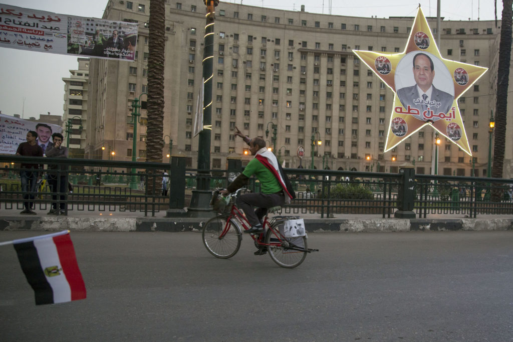 A supporter of Abdel Fattah el-Sisi campaigns for the president in Tahrir Square ahead of the election today. (Roger Anis/GroundTruth)