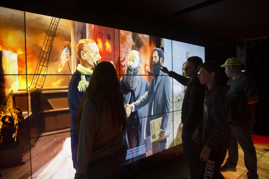 Visitors at an interactive exhibit in the Visionaries Gallery of the Friends of Zion Museum in Jerusalem on March 29,2018. (Heidi Levine/ The GroundTruth Project)