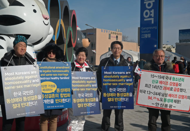 On Feb. 21, 2018, anti-LGBT protesters stand in front of the Gangneung station, a port to several Olympic venues such as ice hockey and figure skating. (Jisoo Hong/The GroundTruth Project)
