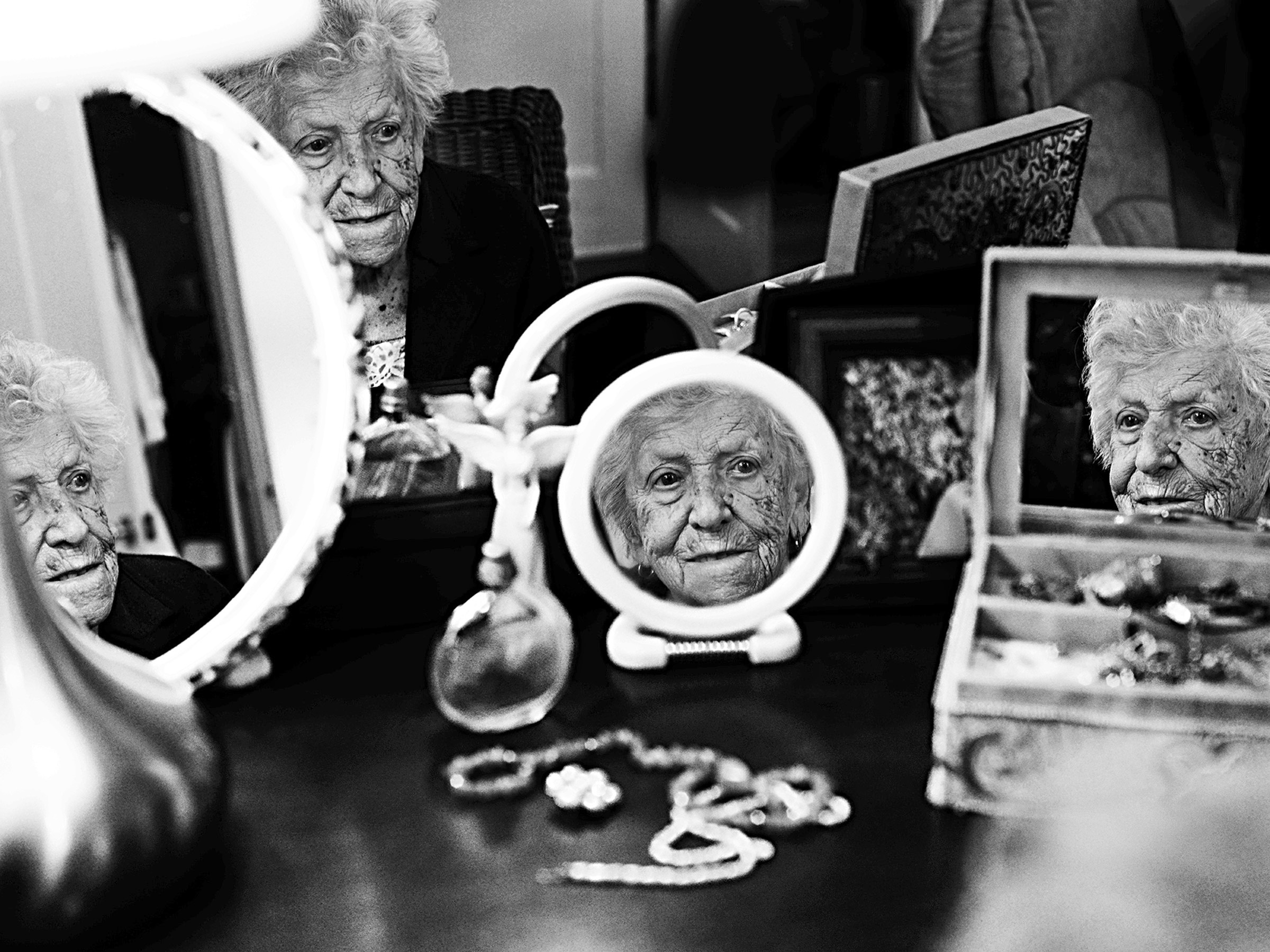 """When I was young I had long hair, nice legs and curves. Young ladies today all strive to be skinny, but I think that real beauty is natural beauty. We are who we are, and that's all that matters."" Anne-Marie Pronovost, 100 years old. She died in 2017. (Arianne Clément/GroundTruth)"
