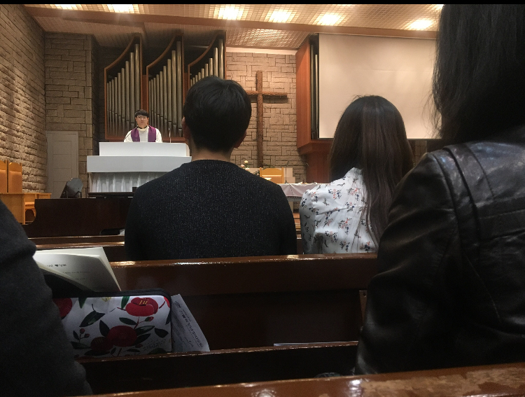 Rev. Peter Choi addresses students at Yonsei University church during mass. (Tommy Brooksbank/GroundTruth)