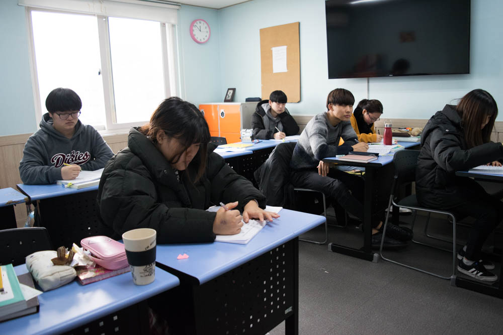 Around 50 students from elementary to high school attend the Durihana International School. Students take classes in math, history, science, Korean, English, music, art, and moral studies. The school was founded by the Rev. Chun Ki Won. (Rachel Cohrs/GroundTruth)