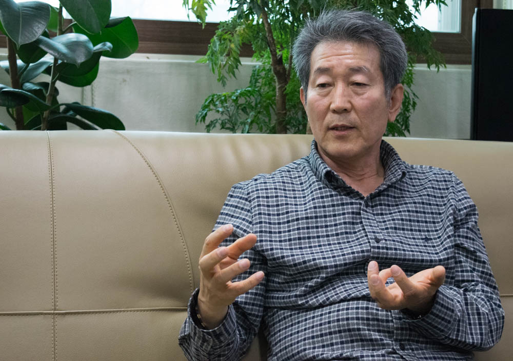 The Rev. Chun Ki Won was first inspired to work for North Koreans since he first went to the border as a businessman in 1995. He later became a pastor and founded a school and church to support North Koreans and help them integrate once they arrive in South Korea. (Rachel Cohrs/GroundTruth)