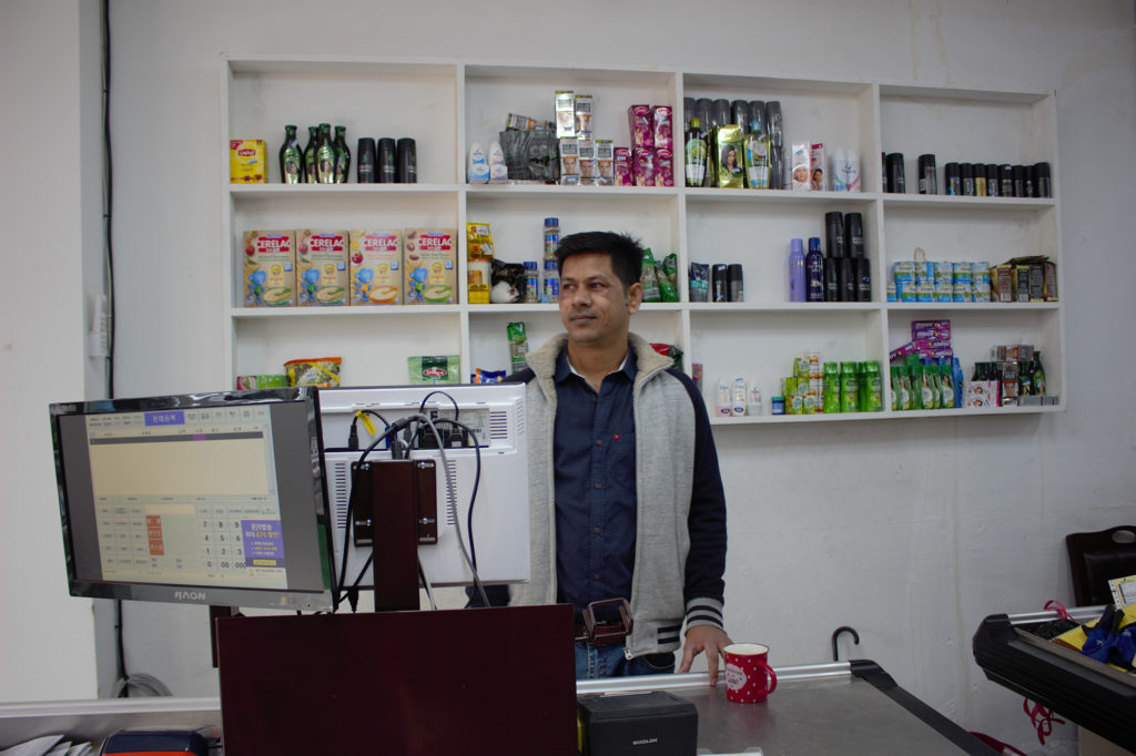 Mohammed Shohan Khan works for a relative's business in Seoul. Although educated as a pharmacist in Bangladesh, he wants to stay in Korea for as long as he can. (Razzan Nakhlawi/GroundTruth)