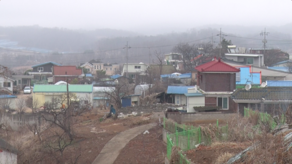 From the hills of Tongil Chon, North Korea is within sight. (Ryan Thompson/GroundTruth)