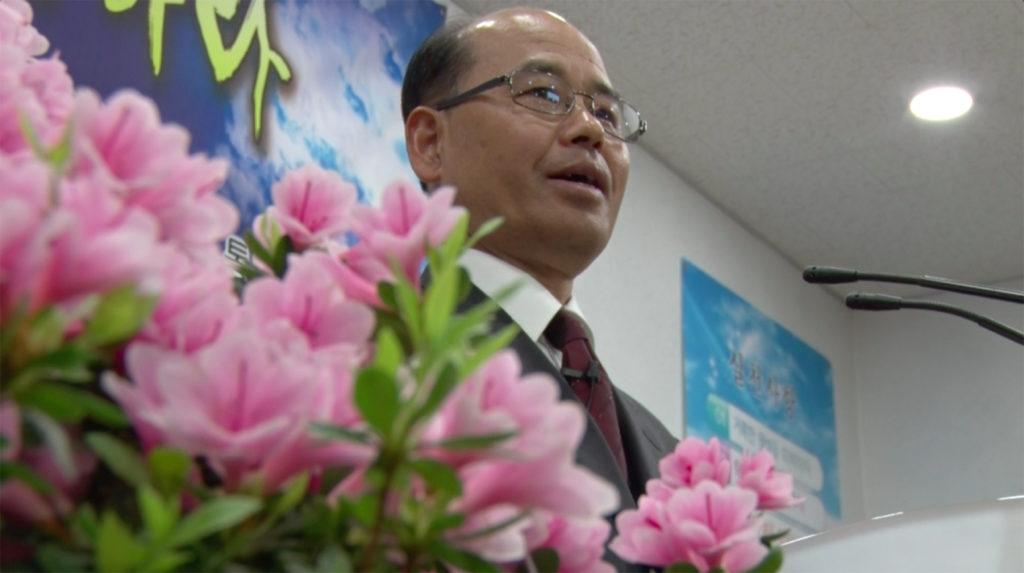 Pastor Gang Suk Jin prepares his sermon at Tongil Chon's only church. (Aziza Kasumov/GroundTruth)