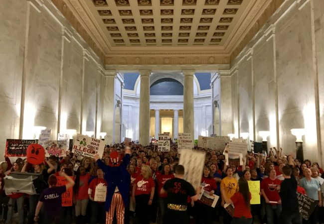 "While covering the teachers' strike in West Virginia, Molly Born ran into people she grew up with. ""People I hadn't seen or thought of in years were suddenly those whose stories I was covering,"" she writes. (Molly Born/WVPB/GroundTruth)"