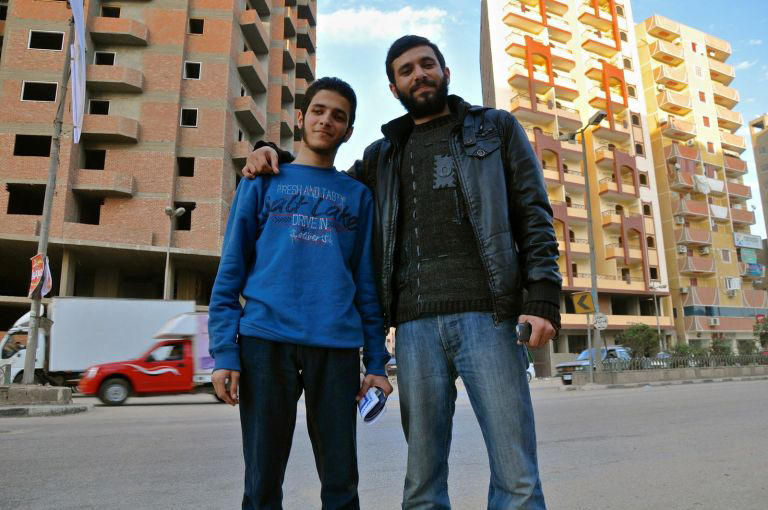 Ahmed and his younger brother, Omar, pictured in 2013. Omar has since disappeared. His family doesn't know where he is, although he calls every two weeks or so. (Lauren Bohn/GroundTruth)