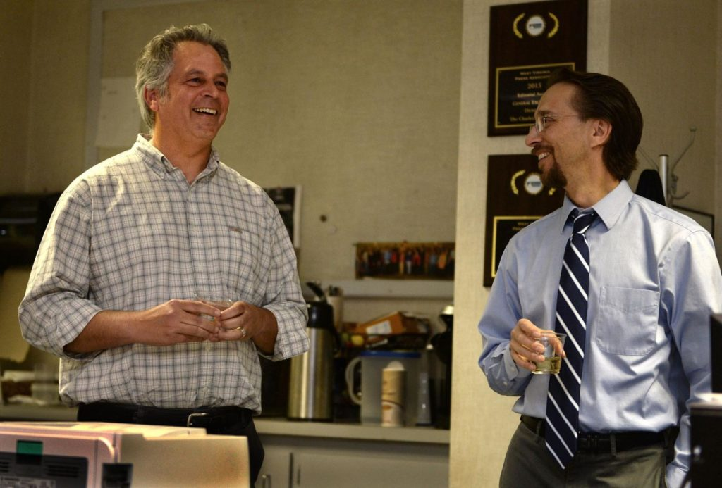 Gazette-Mail reporter Eric Eyre (left) talks with then-Executive Editor Rob Byers in the Charleston Gazette-Mail newsroom after Eyre won the 2017 Pulitzer Prize for investigative reporting.