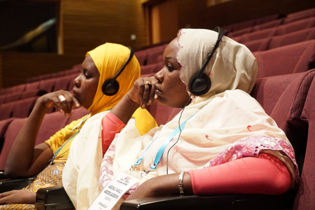 Attendees of the Girls Not Brides conference in Kuala Lumpur listen through a translator. (Photo by Lucy Lyons/GroundTruth)