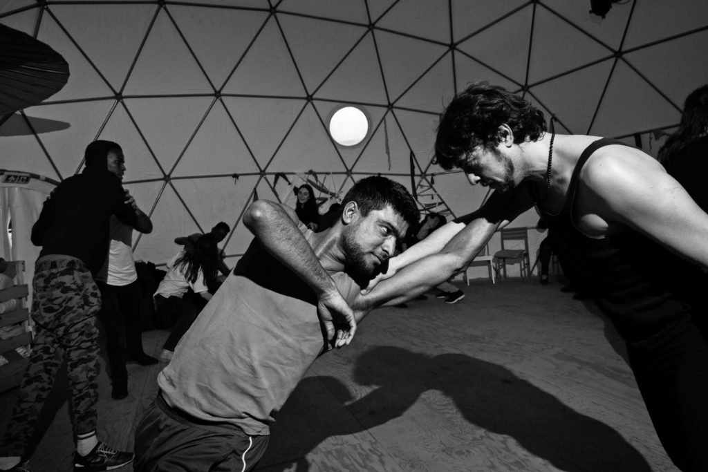Visiting artist Pierre-Yves Massip (right) — one half of the French theater company Compagnie Mangano-Massip — co-leads a February 15 workshop on physical theater. (Photo by Annabelle Marcovici/GroundTruth)