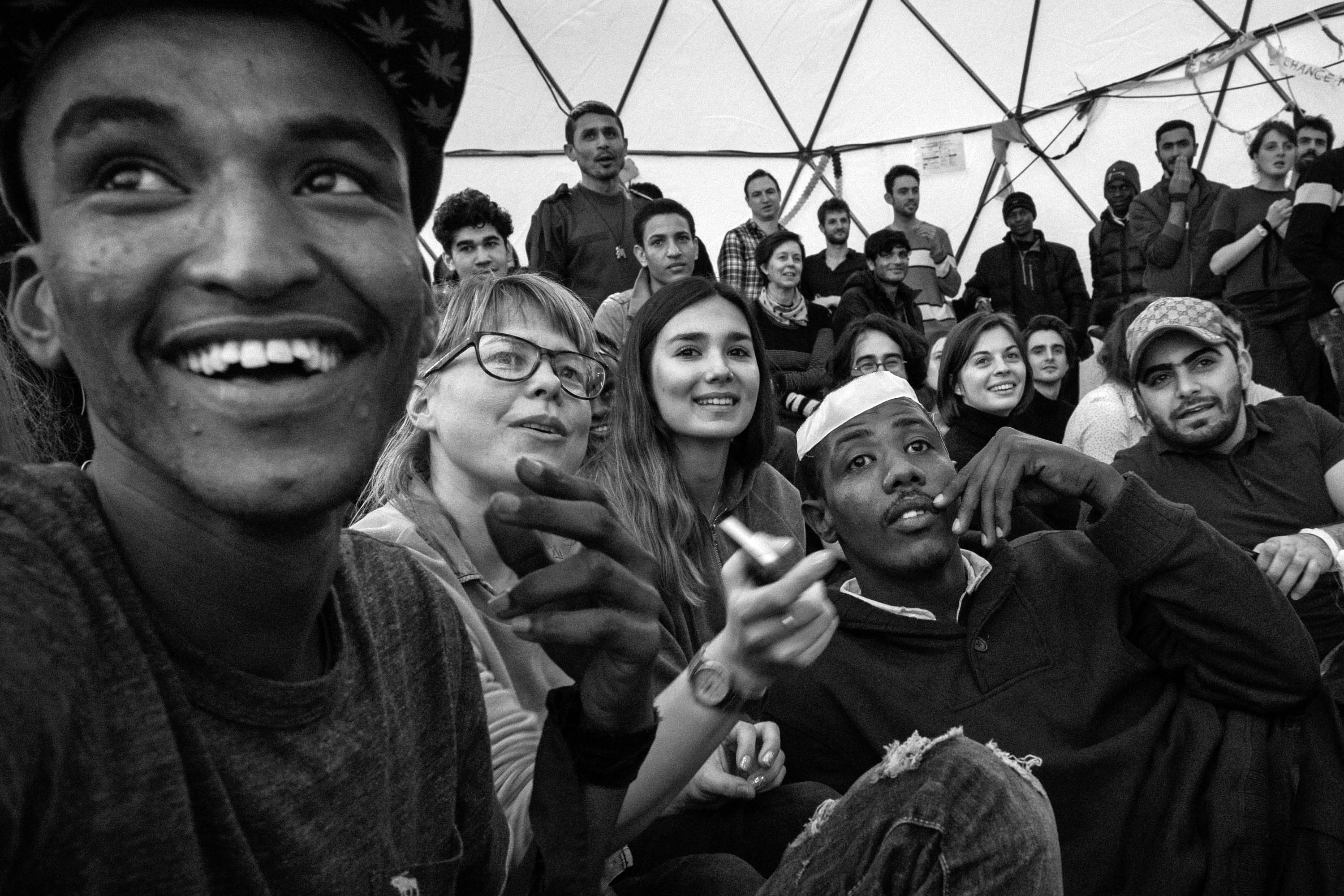 Photographer Annabelle Marcovici takes us inside the theater that popped up next door to France's first temporary shelter for asylum seekers. (Photo by Annabelle Marcovici/GroundTruth)
