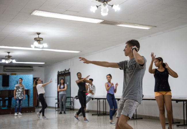 Abel Hernandez Eskenazi, front right, dances with other members of the youth organization at their weekly dance group May 14. Eskenazi, 17, has been leading religious services since his Bar Mitzvah four years ago. (Photo by Riley Robinson/The GroundTruth Project)