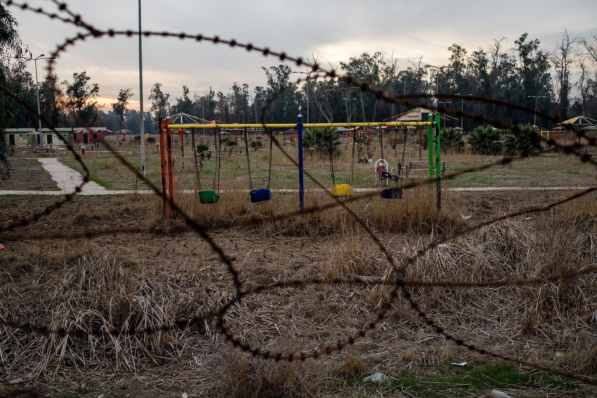 Swings sit empty in a playground city where two disabled boys were found wandering the grounds alone. (Alex Potter/GroundTruth)