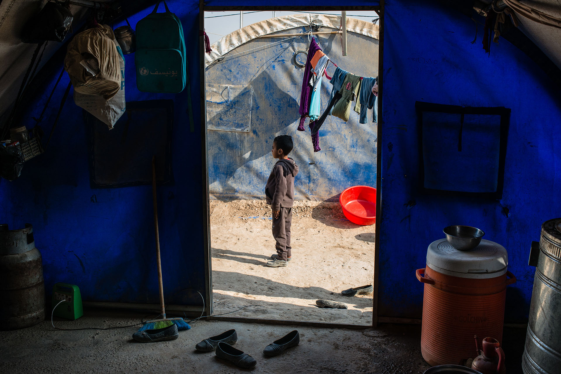Saqer, a young Sunni boy who suffers from symptoms of post-traumatic stress disorder, lives in Qayyara Jaddah camp with his family, who won't return home for fear of retribution from Yazidi neighbors. (Alex Potter/GroundTruth)