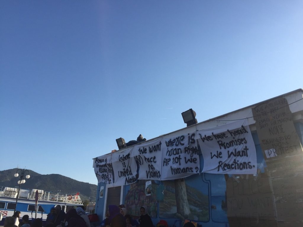 Signs from a recent protest at the refugee camp. (Photo by Holly Young/GroundTruth)
