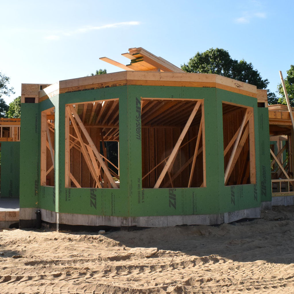 A new home in Orleans, Massachusetts, is built to withstand hurricanes, with strong, reinforced connections that hold the foundation to the walls. Credit Pien Huang/WCAI