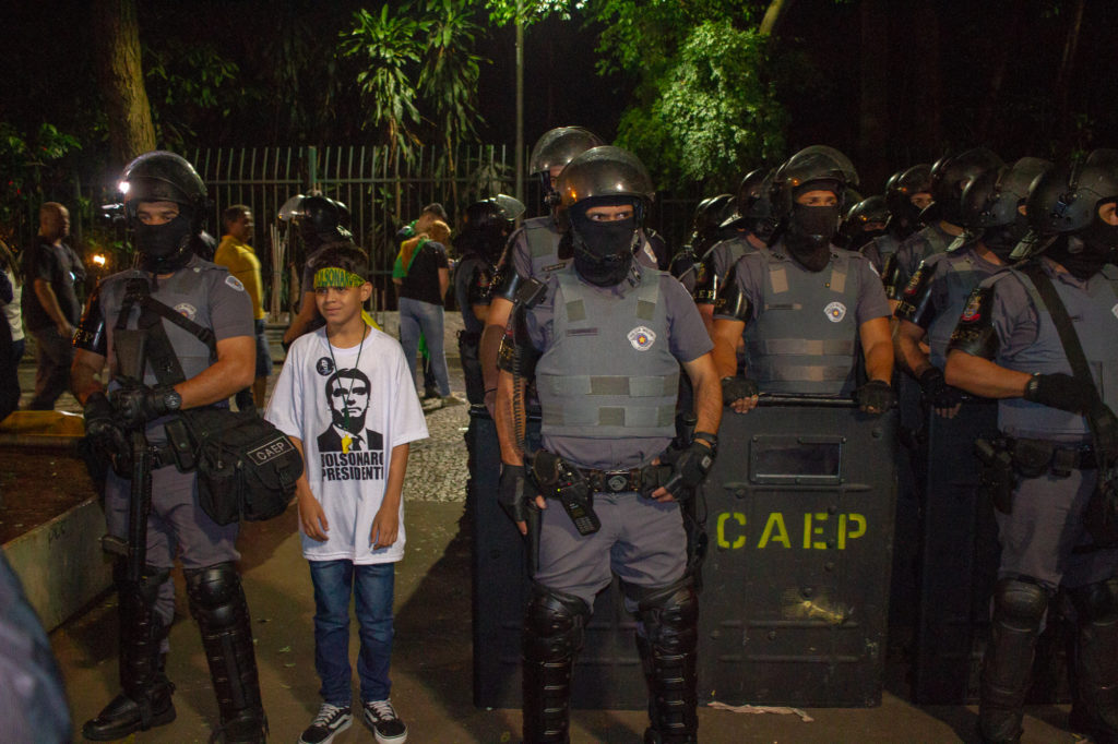 Bolsonaro supporters pose for photos with the police in São Paulo while celebrating the candidate's win in the October 28 election. The president elect has pledged to crack down on crime, ease gun ownership restrictions and change the law so that policemen are not punished for excessive use of force. (Photo by Léu Britto/DiCampana/GroundTruth)
