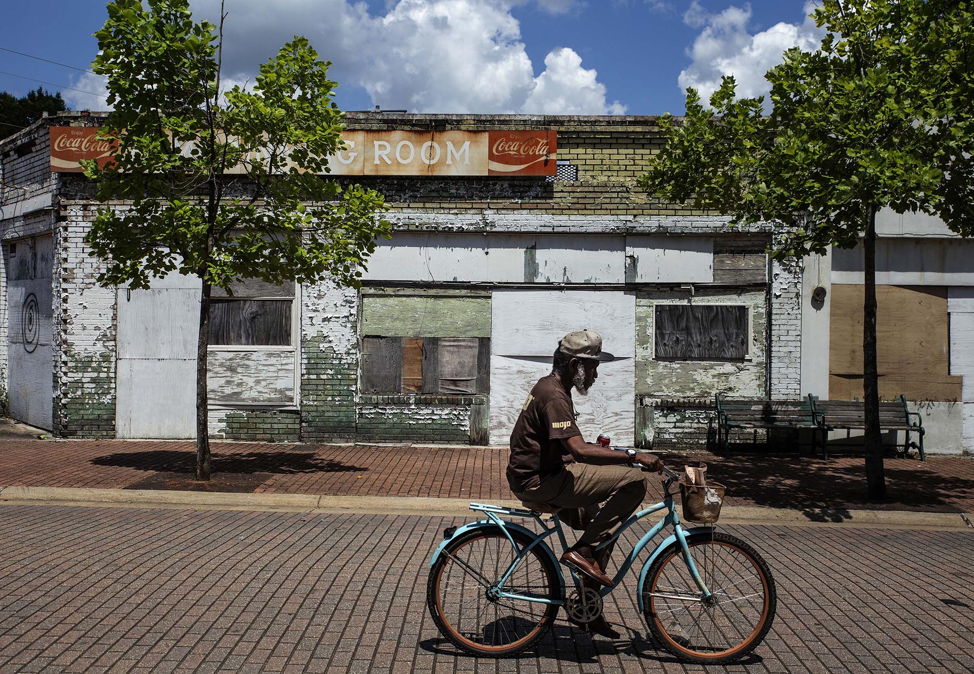 A pedestrian rides his bicycle in the 300 block of Farish Street in Jackson Wednesday, June 27, 2018. (Photo by Eric J. Shelton/GroundTruth)