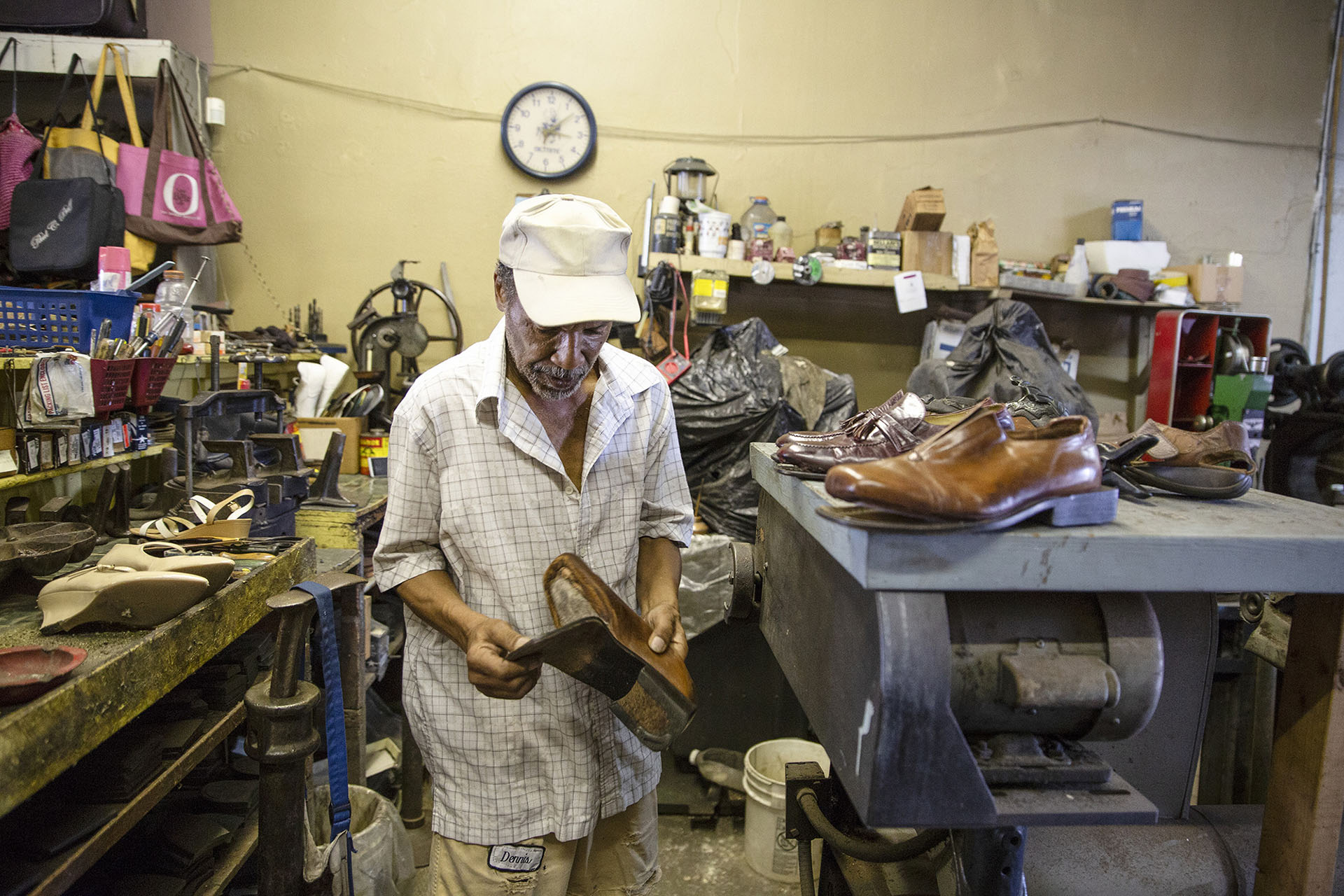 "Tony ""Dr. Shoemaker"" Brothers works on a customer's shoes at his family's business, Dennis Brothers Shoe Repair Service, in the 300 block of Farish Street in Jackson Wednesday, June 27, 2018. (Photo by Eric J. Shelton/GroundTruth)"