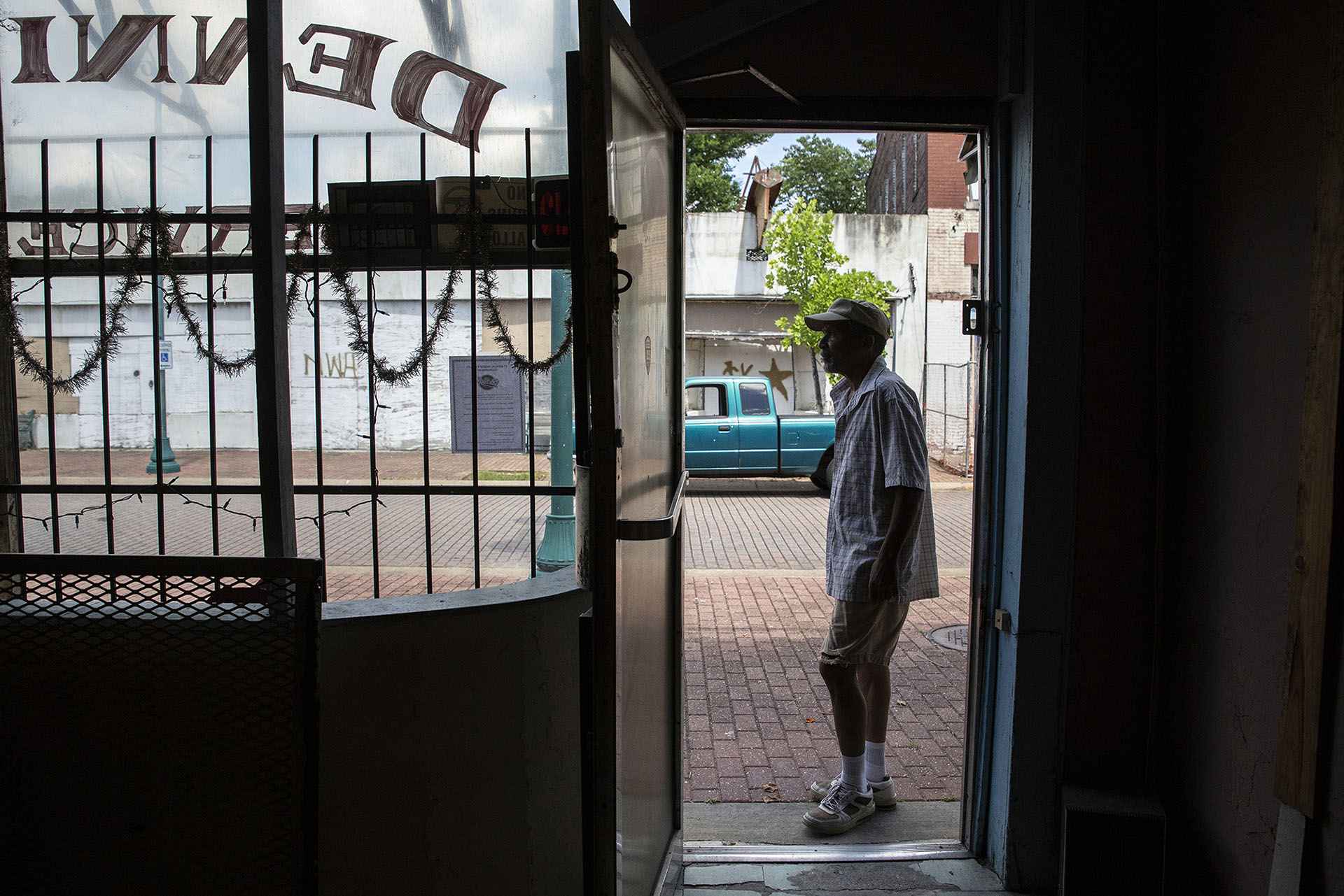 "Tony ""Dr. Shoemaker"" Brothers looks at Farish Street while at his family's business, Dennis Brothers Shoe Repair Service in the 300 block of Farish Street in Jackson Wednesday, June 27, 2018. (Photo by Eric J. Shelton/GroundTruth)"