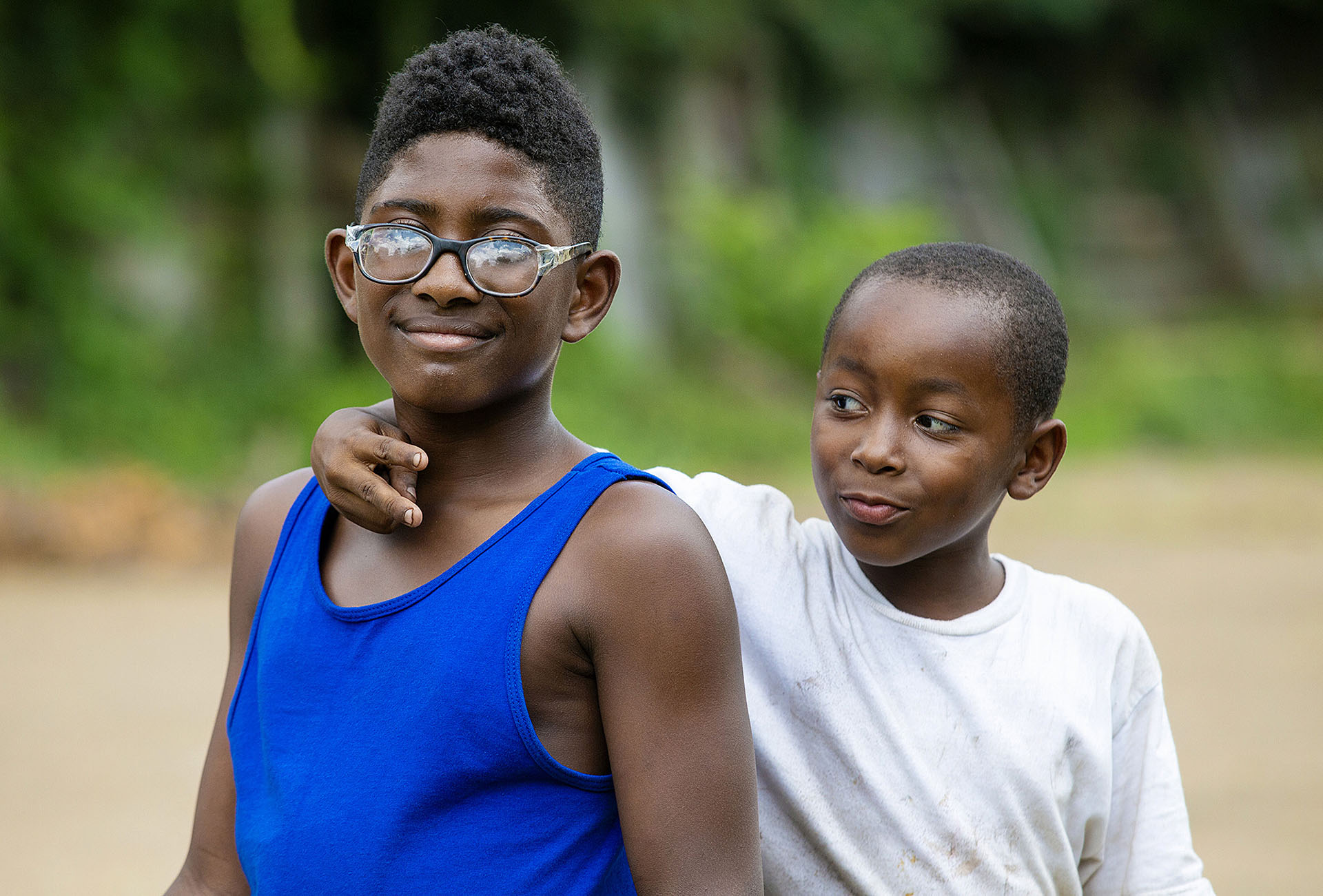 Shannon Sturgis, 11, and Jamichael Burgess, 8, pose for a photograph on Leonard Street in Jackson's Farish Street Historic District Thursday, July 5, 2018. (Photo by Eric J. Shelton/GroundTruth)
